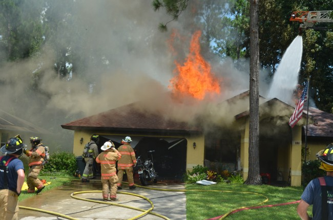 The fire halfway through consuming the house. Click on the image for larger view. (© FlaglerLive)
