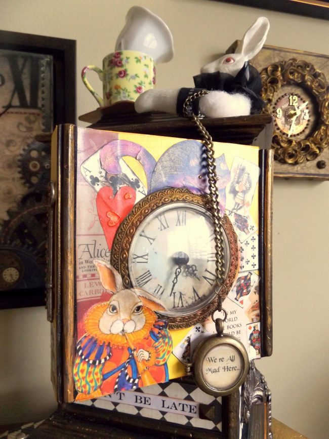 'Don't Be Late,' Judi Wormeck's Alice-in-Wonderland-themed, mixed-media clock-artwork, won Best of Show at 'It's About Time,' a recent multi-artist, themed exhibition at the Flagler County Art League. Click on the image for larger view. (© FlaglerLive)