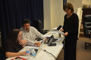 Board Chairman Andy Dance tallying up figures with Board Attorney Kristy Gavin, standing, and Finance Director Patty Wormeck during a 3 p.m. break.