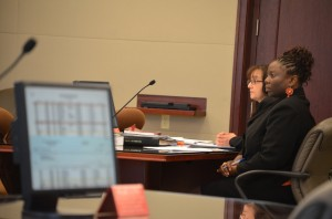 Wray and her attorney, Assistant Public Defender Regina Nunnally, as the prosecutor analyzed checks Wray wrote to herself, listed on computer screens in the courtroom. Click on the image for larger view. (© FlaglerLive)