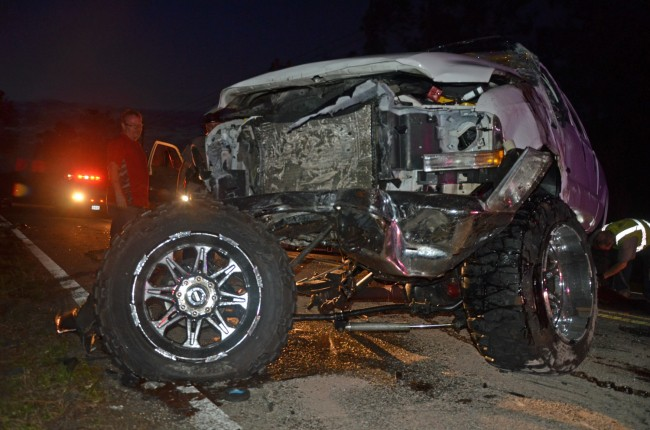 The Ford F350 after it was righted. The man to the left is John Rogers, who supervised his company's (John's Towing) removal of the wreckage. Click on the image for larger view. (© FlaglerLive)