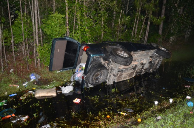 The 1997 Toyota SUV rolled and spun before ending up in a ditch, facing south, off the northbound lanes of U.S. 1 in Palm Coast. Click on the image for larger view. (© FlaglerLive)