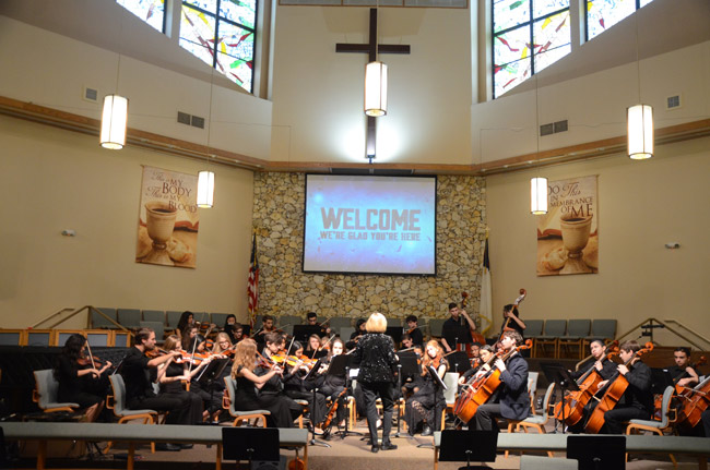 A concert series Palm Coast's First United Methodist Church includes events like the Flagler Youth Orchestra's top ensemble's annual performance in winter. No part of the event is religious in nature, though it takes place in the church's sanctuary. But the church's grant application drew questions regarding its 'outreach ministry' when the Palm Coast City Council discussed it this week. (© FlaglerLive)