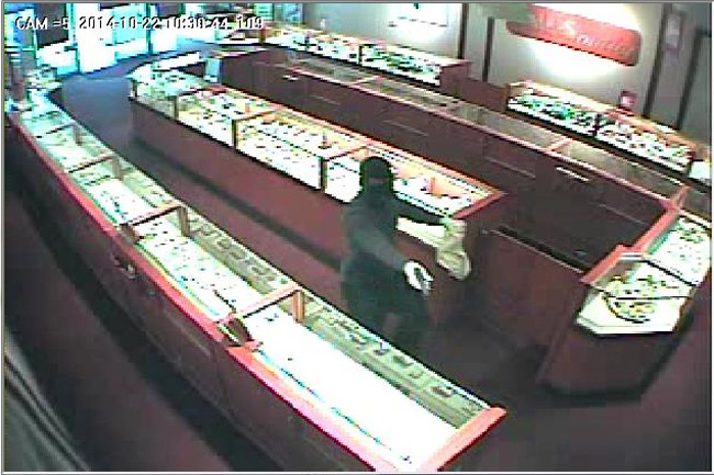 A surveillance video capture of the armed robber.